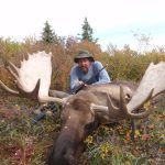 Alaska Moose Hunter with his Moose - Vrem Hunting Guide Service